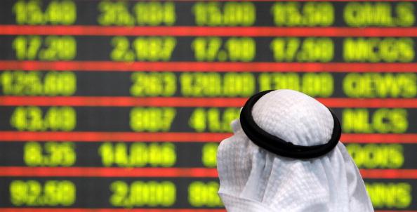 A Qatari investor follows the stock mark